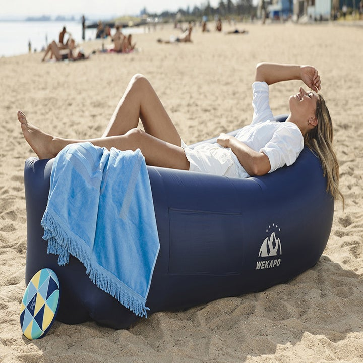 A model lounging on a blown up lounger