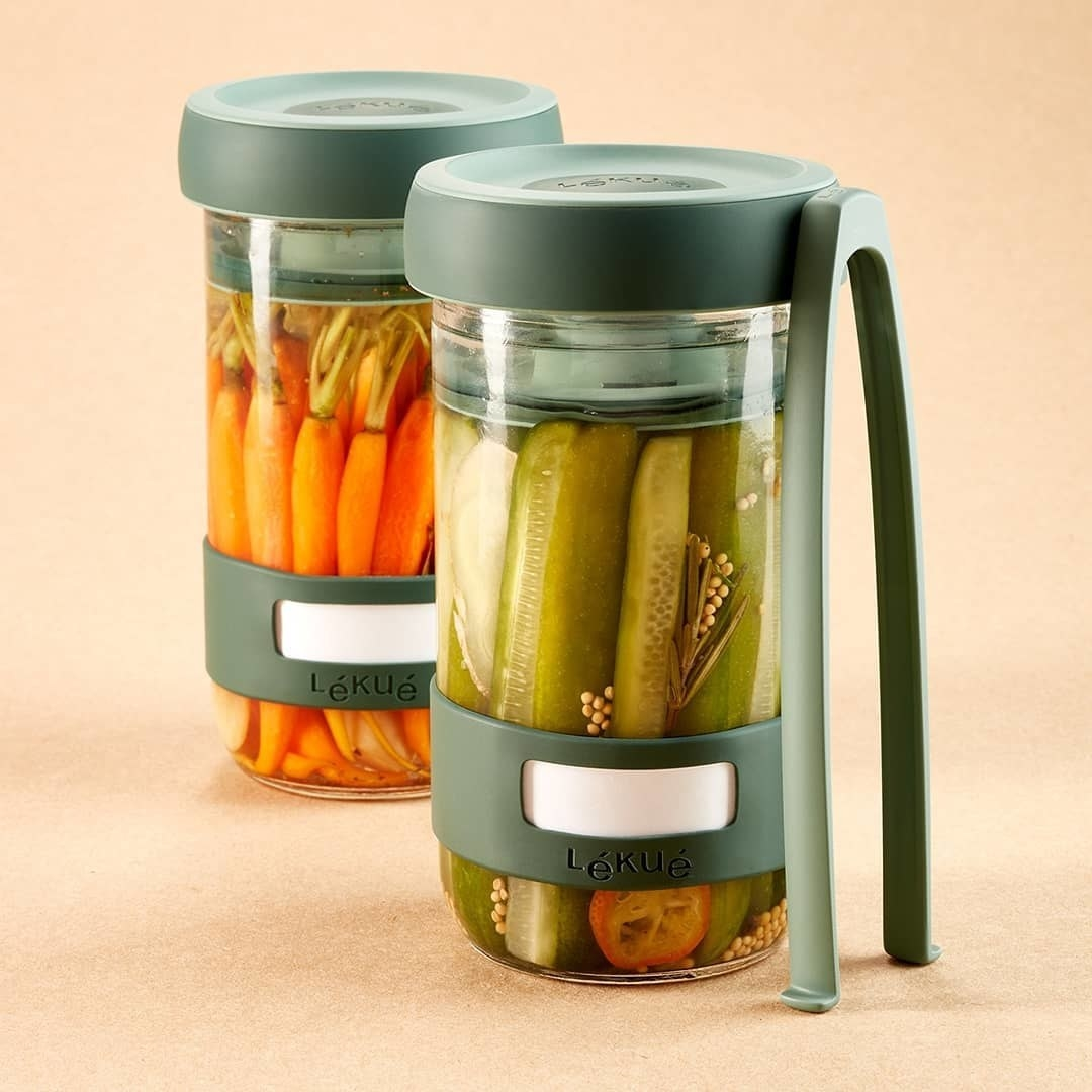 Two pickling containers filled with pickled veggies