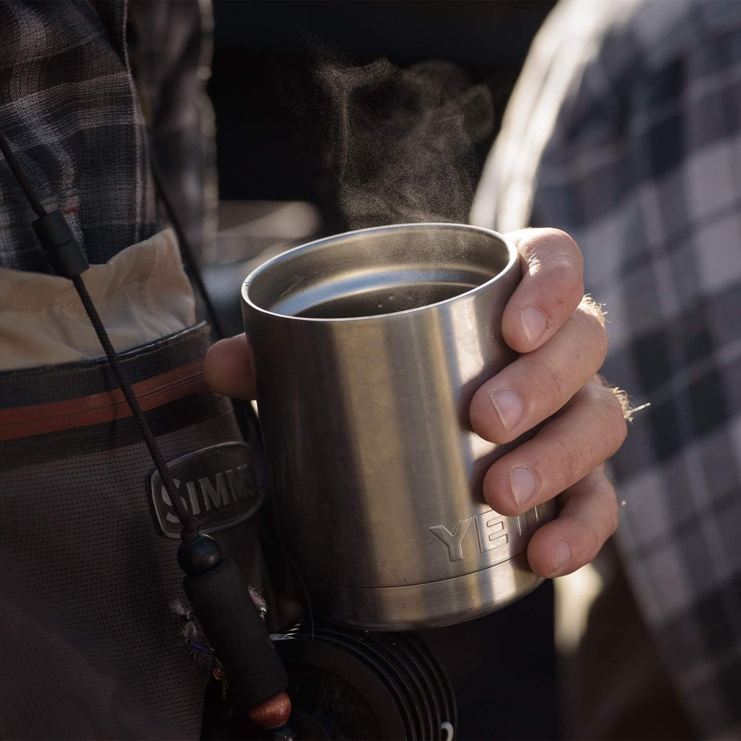 Product photo showing YETI rambler in person's hand. It's about the size of a coffee cup and can easily be held with one hand.