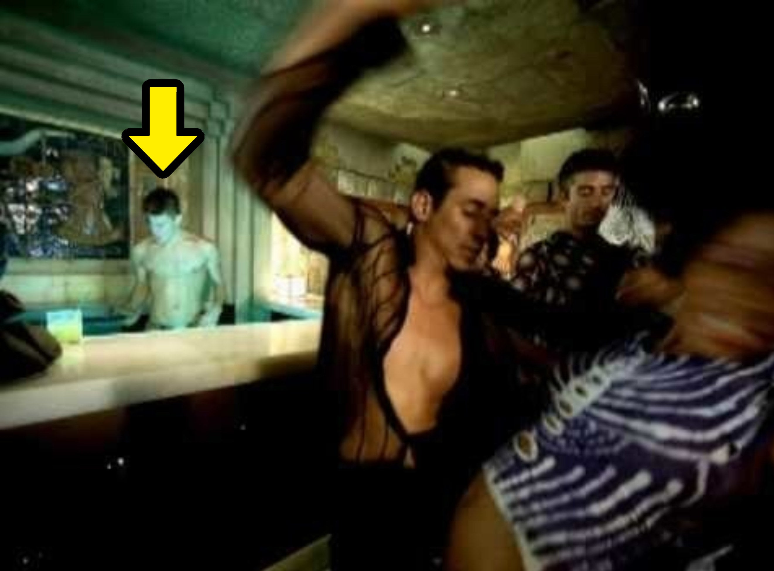 Channing shirtless behind the bar as Ricky dances