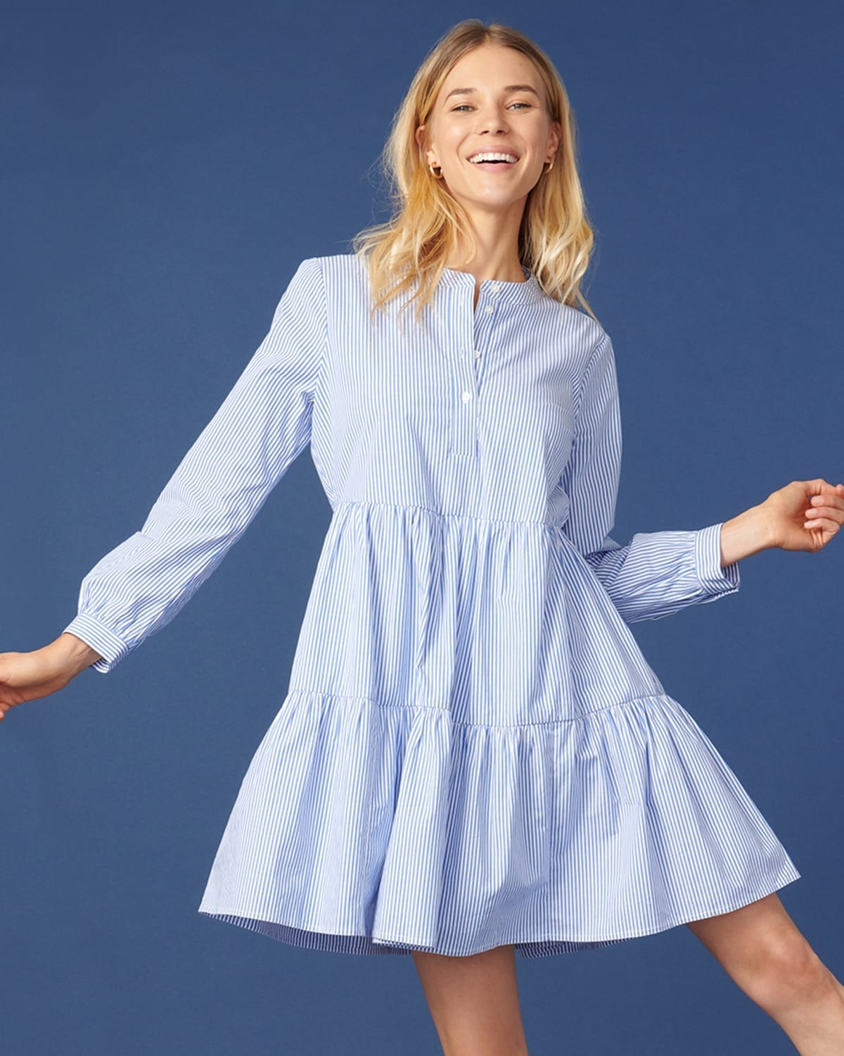 Poplin dress in a blue and white stripe pattern and button up neckline