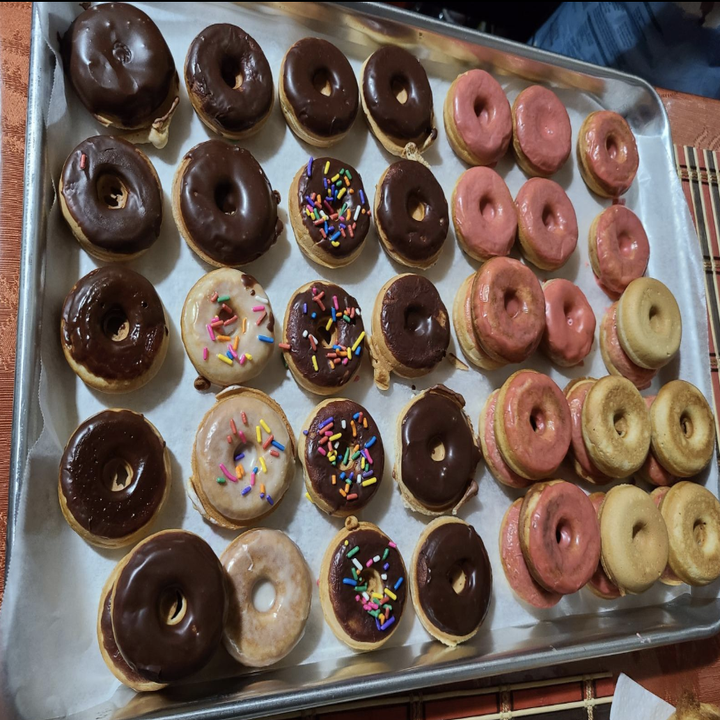 reviewer image of a sheet of donuts with different frostings on them
