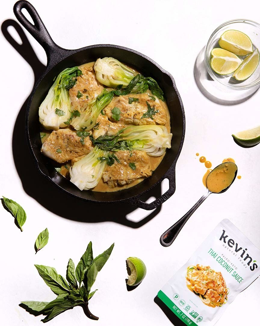 cast iron pan with the Thai Coconut Sauce cooking with chicken and bok choy