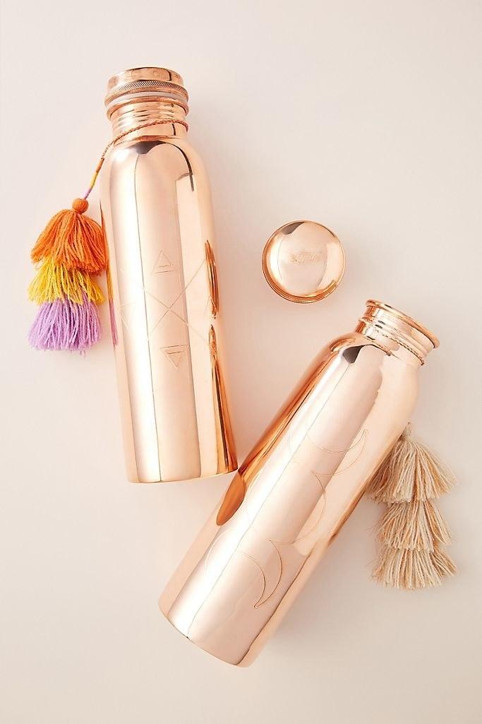 Product photo of Anthropologie Tamra Ayurvedic copper water bottles.