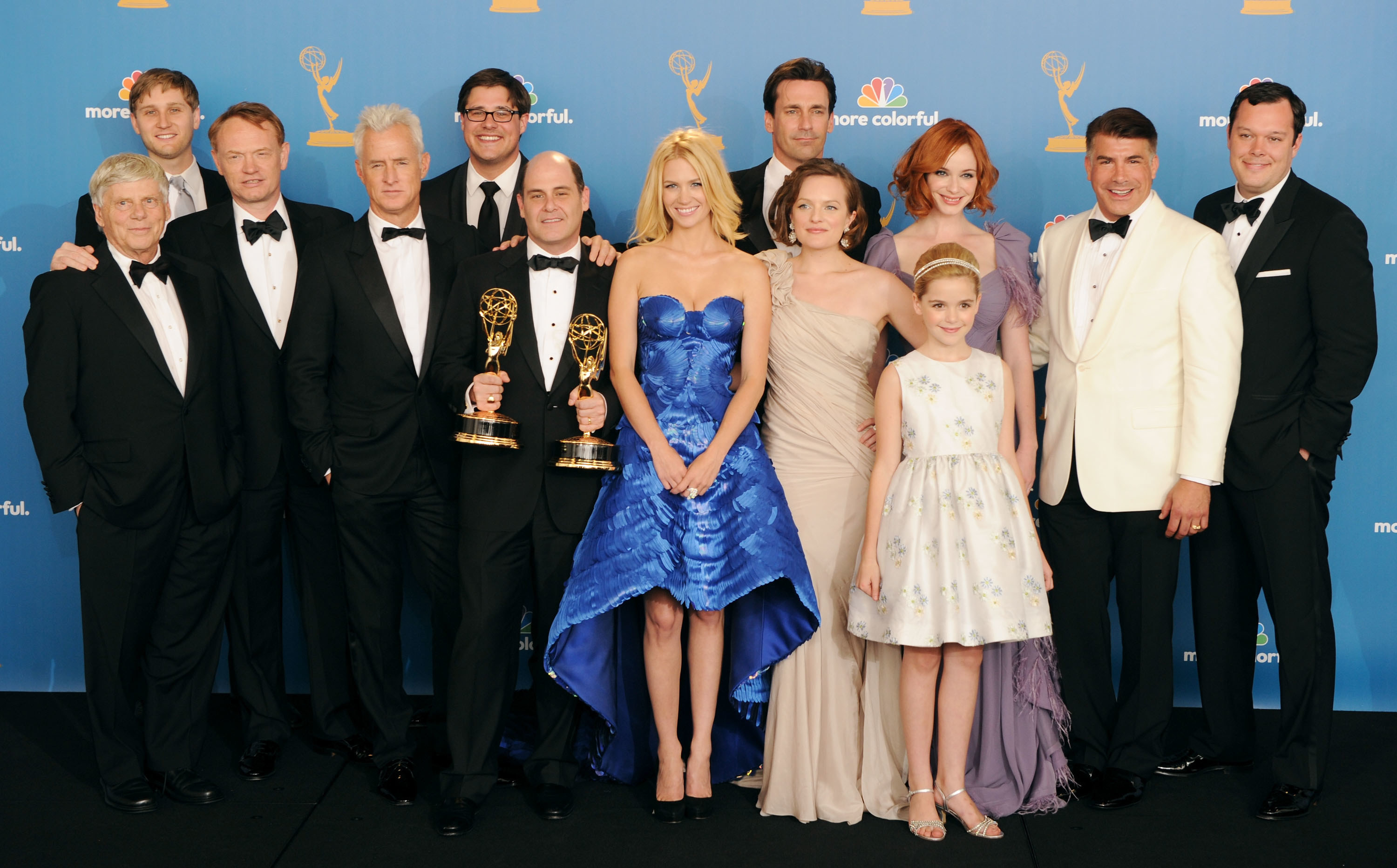 """Cast and crew of """"Mad Men"""" posing backstage after winning the Outstanding Drama Series Emmy."""