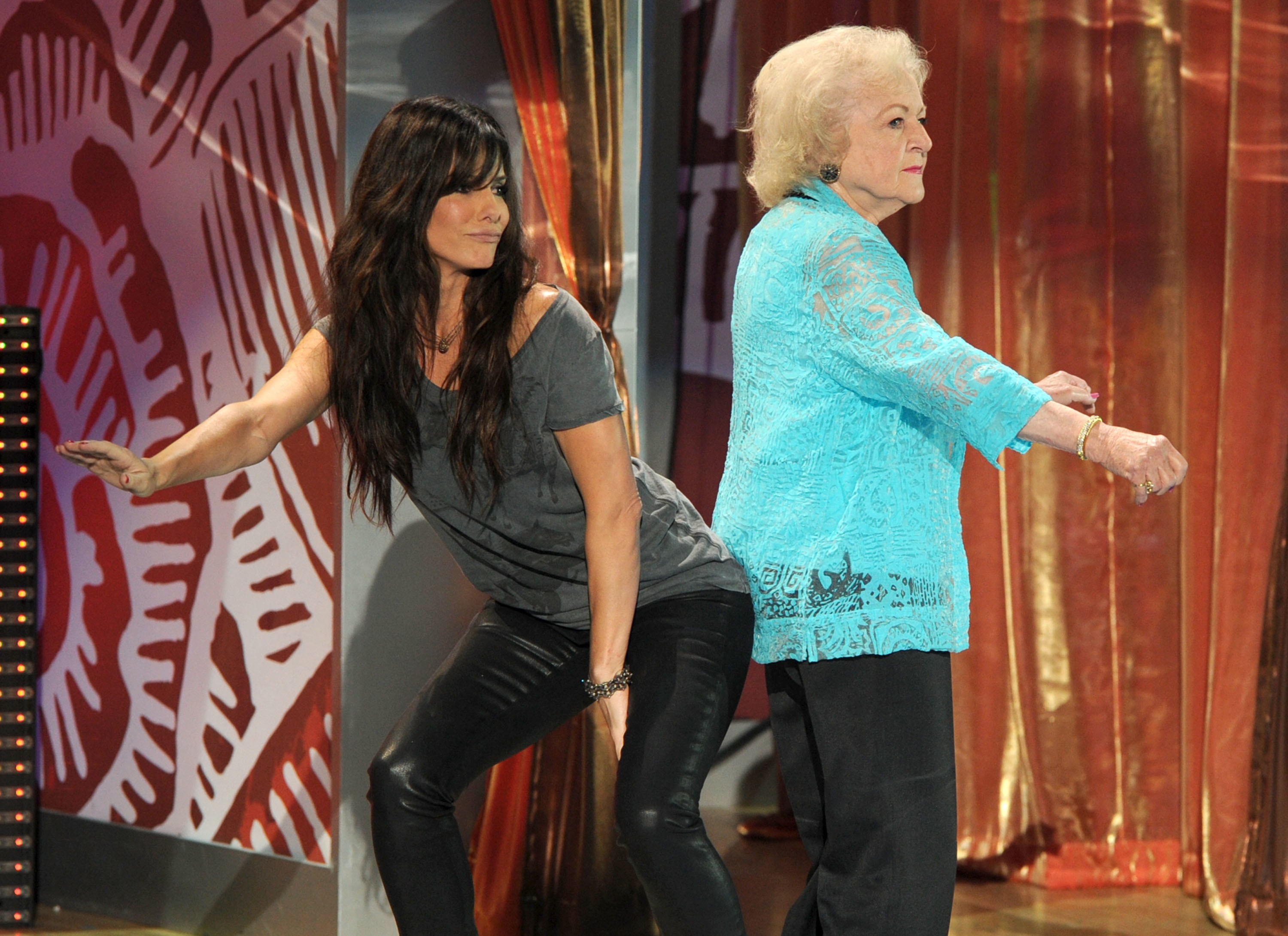 Sandra Bullock grinding her buttocks against Betty White's bum on stage at the Teen Choice Awards.