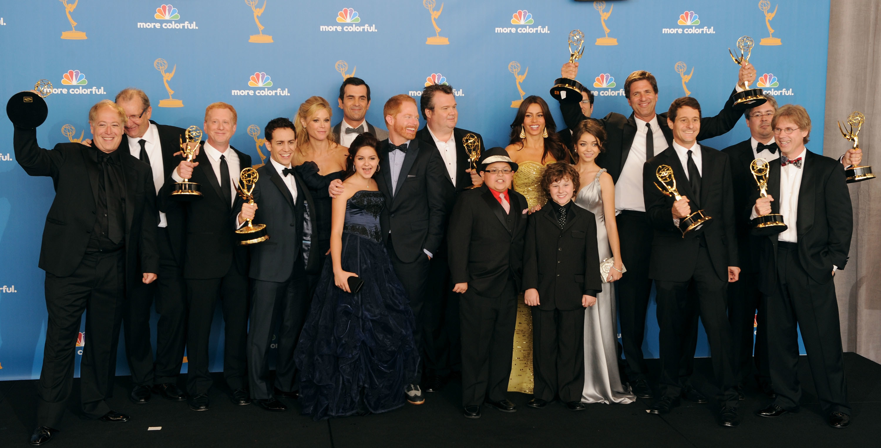 """Cast and crew of """"Modern Family"""" posing backstage after winning the Outstanding Comedy Series Emmy."""