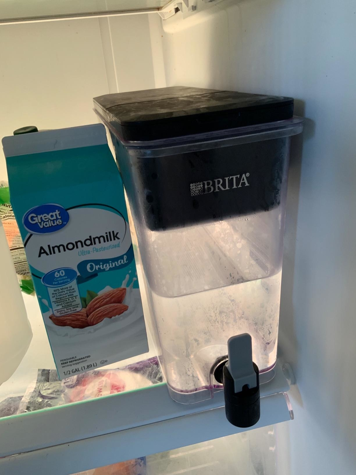 A rectangular clear plastic Brita water filter with black top and spout