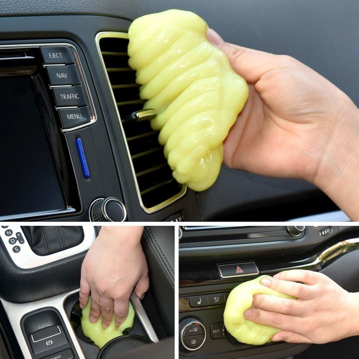 A person using the cleaning gel in a car