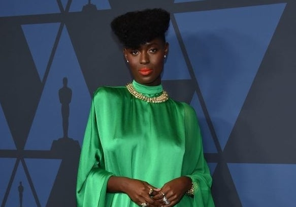 Jodie Turner-Smith posing in a gown at the Oscars