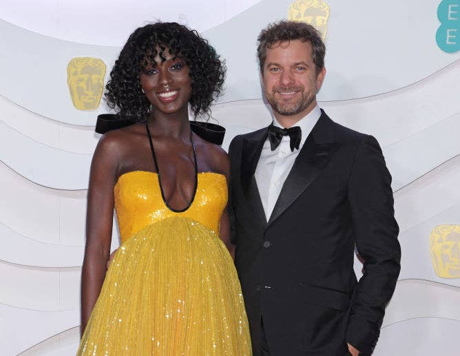 Jodie Turner-Smith and Joshua Jackson posing together at a Hollywood event