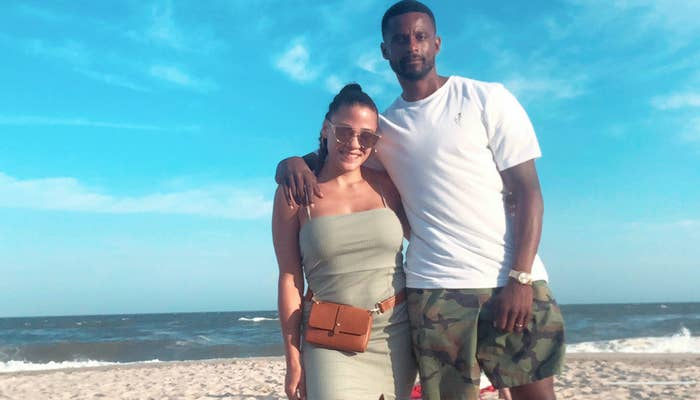 Dean Gaskin stands with his arm around his wife, Jasmin, while on a sunny beach.
