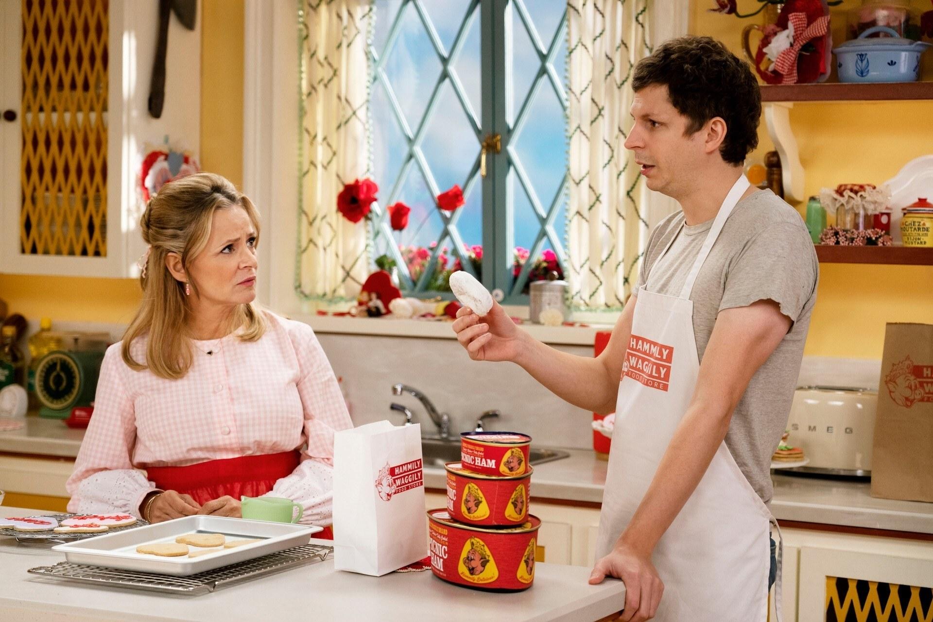 amy sedaris and michael cera talking in a cute kitchen