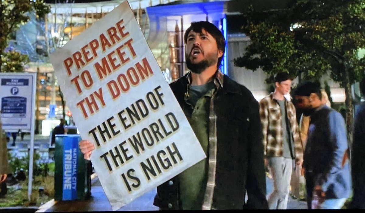 "Will Wheaton holding a sing reading ""Prepare to meet thy doom the end of the world is nigh"""