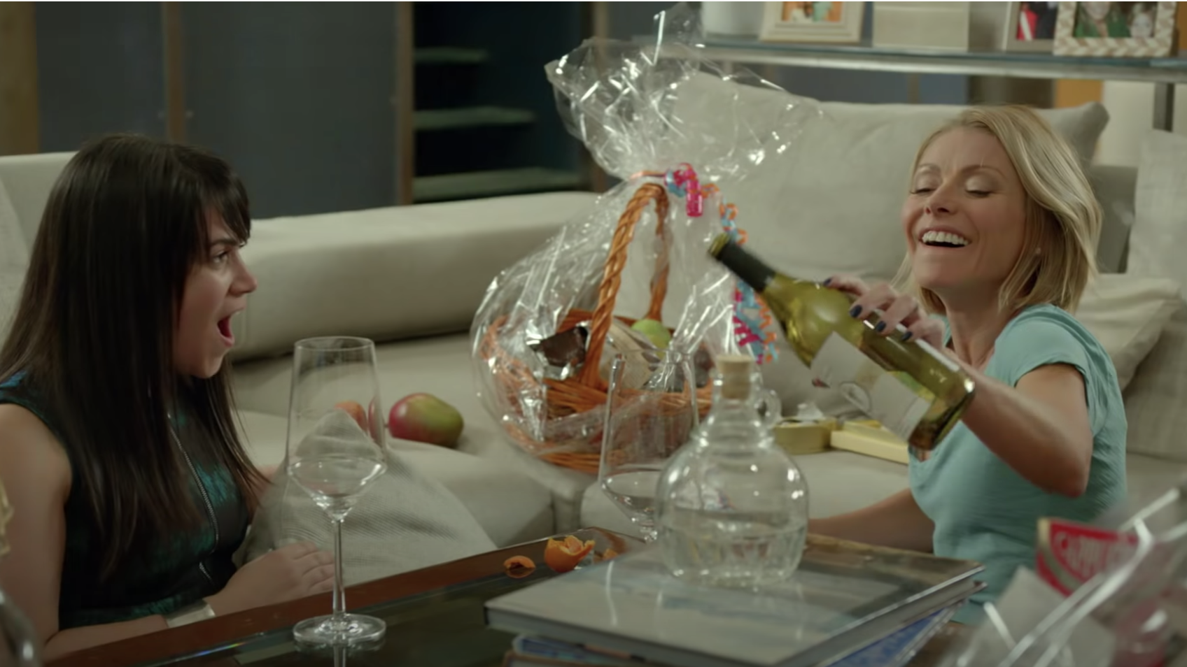 A drunk Kelly Ripa pours wine on Broad City