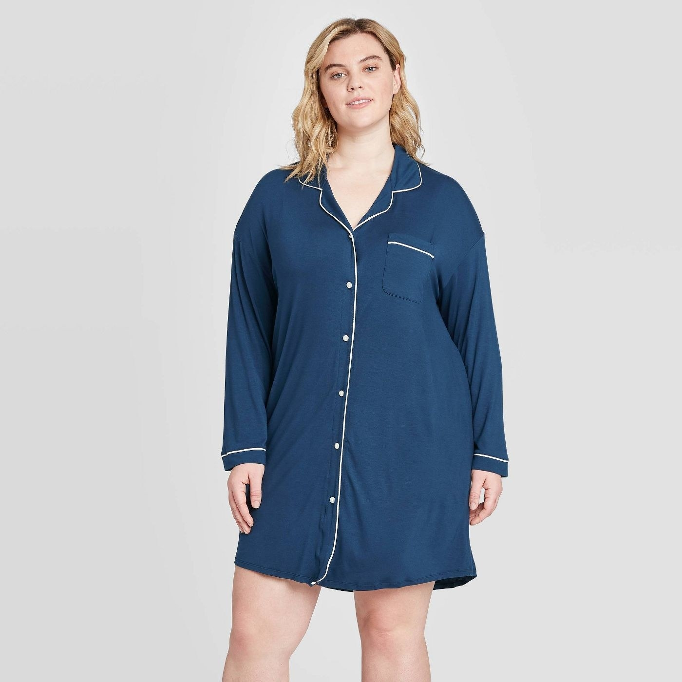 model wearing button-up sleeved blue nightgown with white trim