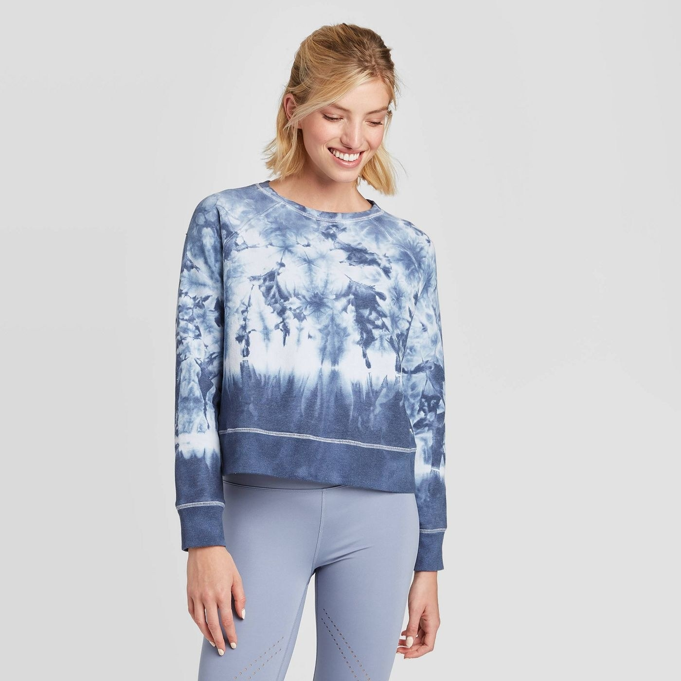 model wearing blue and white tie dye sweater