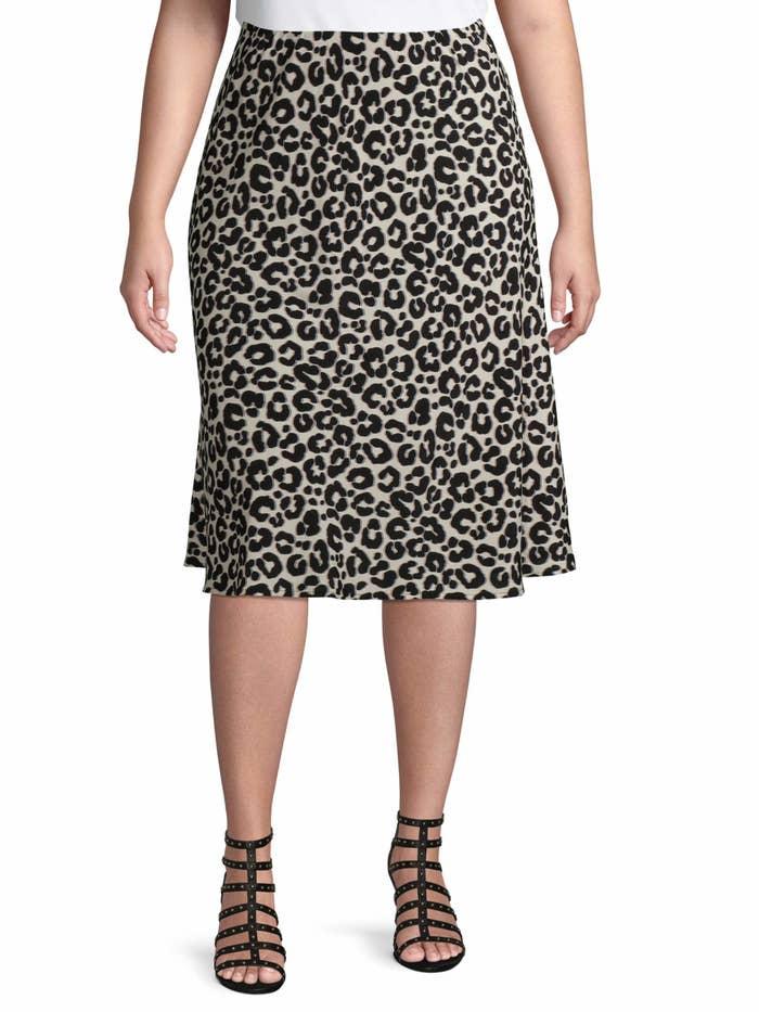 Model wearing the leopard print skirt