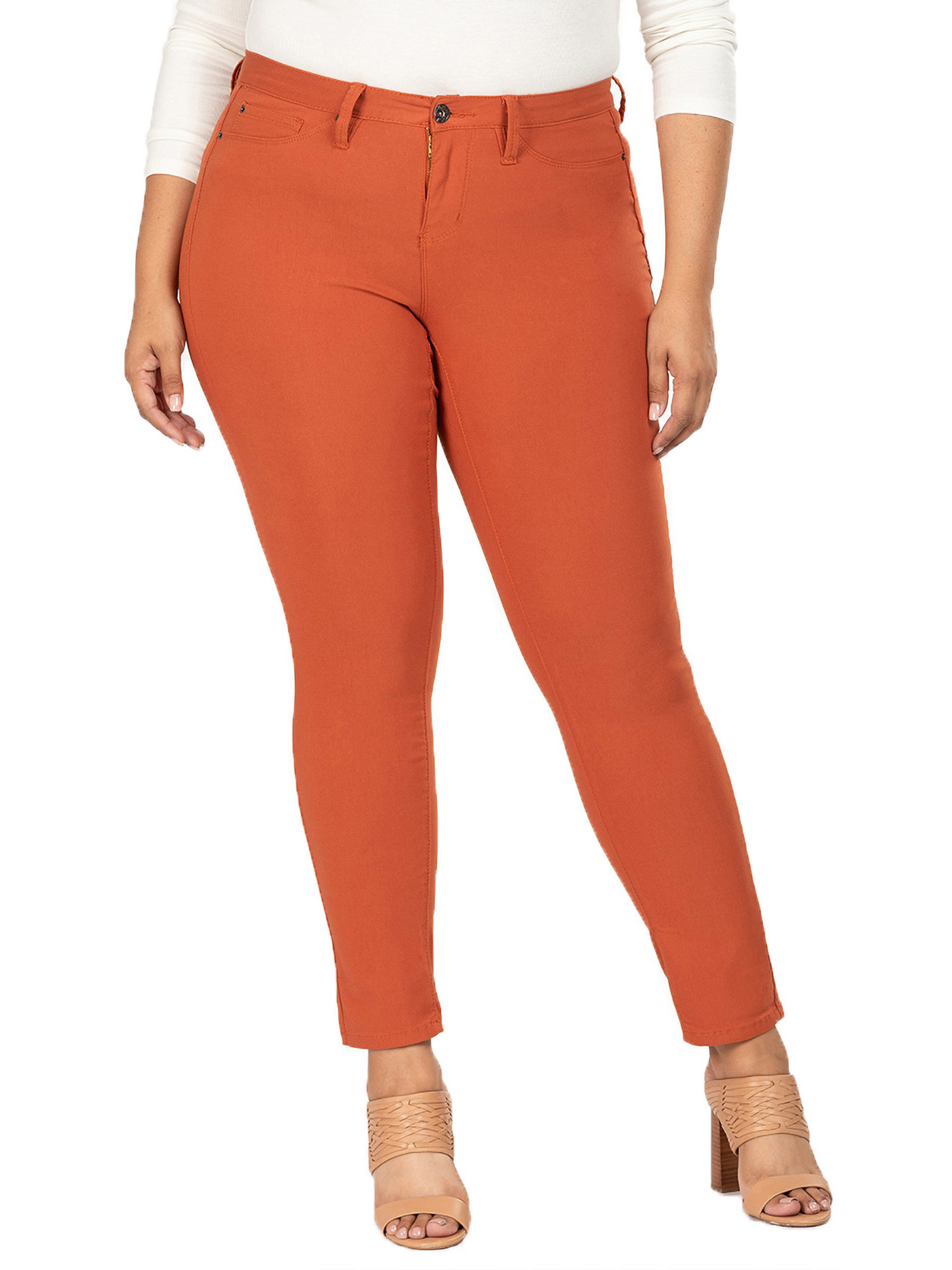 Model wearing the orange skinny jeans