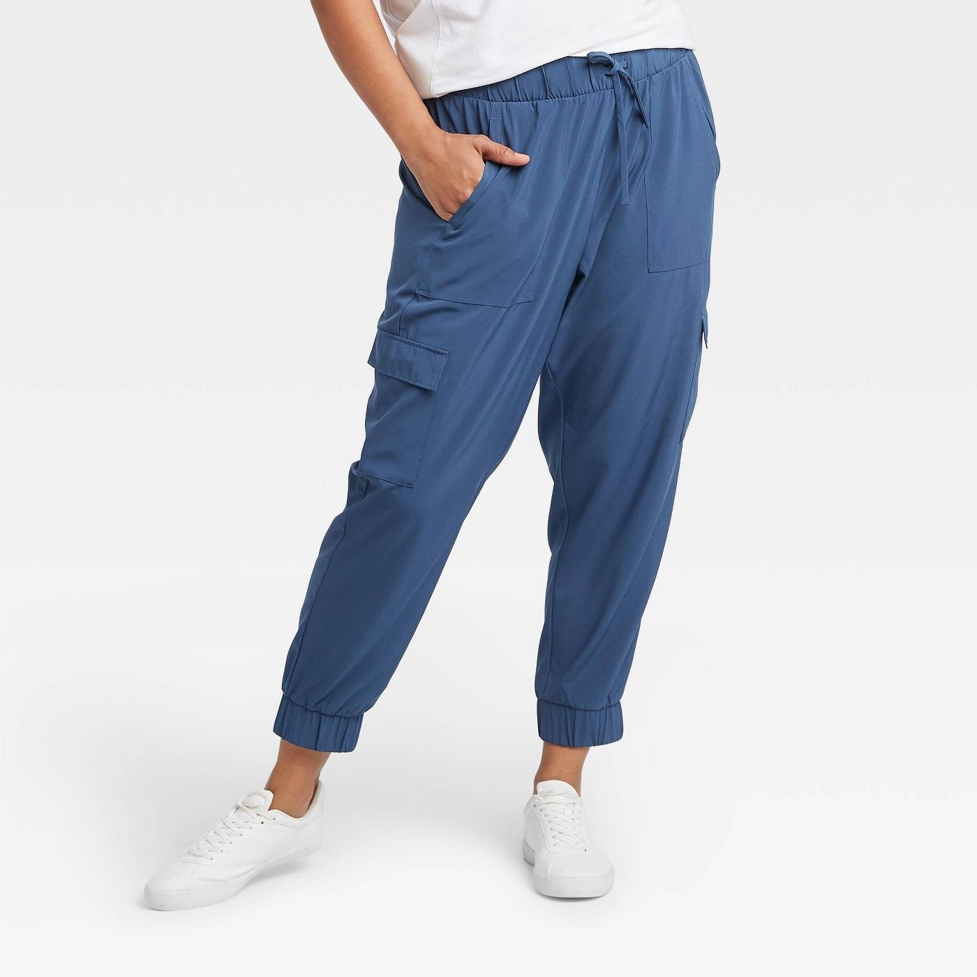 model wearing blue joggers with drawstring waist