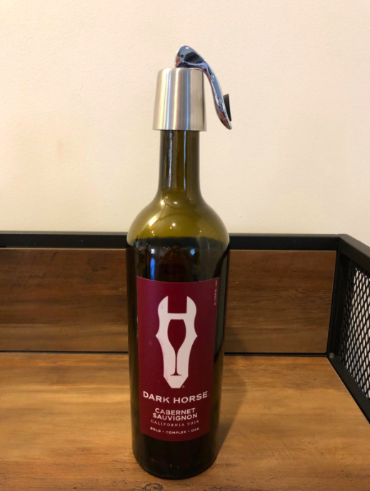 Reviewer photo showing the wine stopper in use on a bottle of red wine