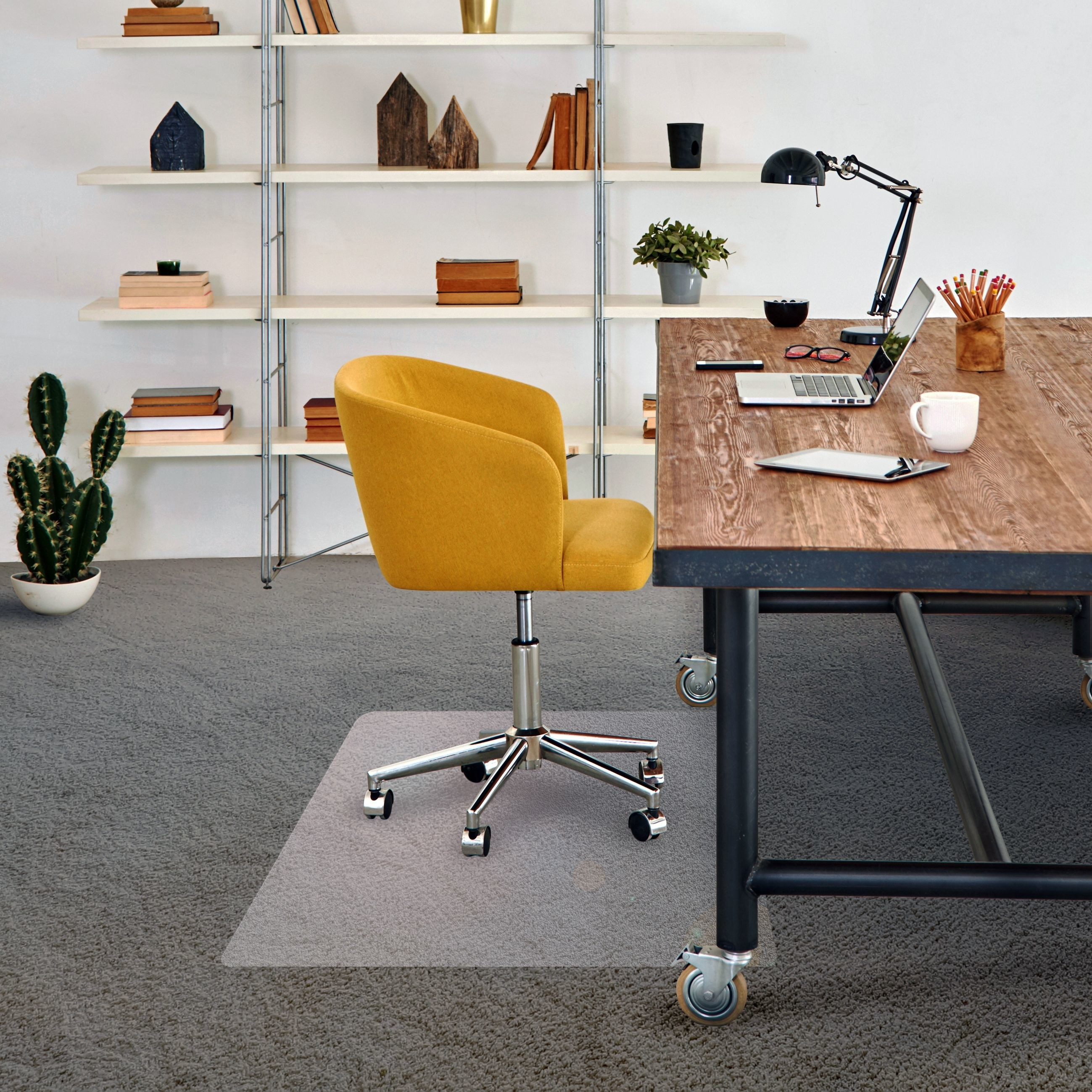 Clear plastic mat with a wheeled chair atop it