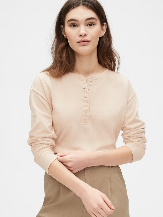 Model wearing the long-sleeve henley in beige