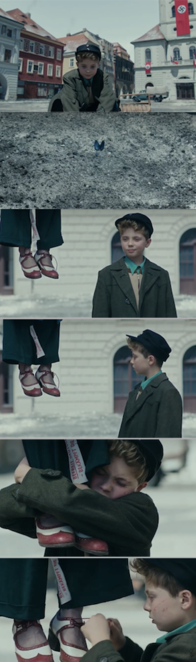 JoJo noticing his mother's shoes, then her lifeless body, as it hangs in the town square