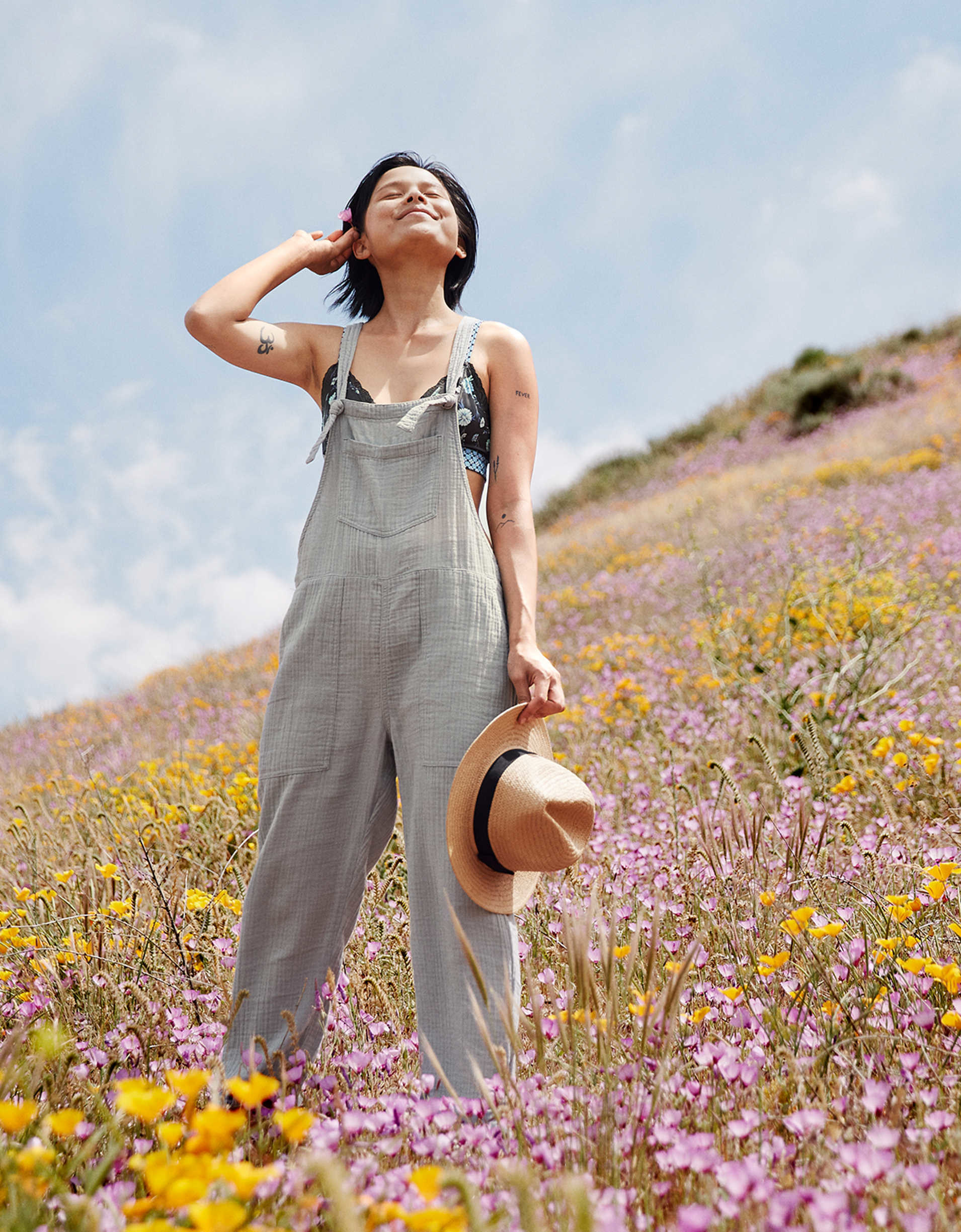 Model wearing the overalls in gray