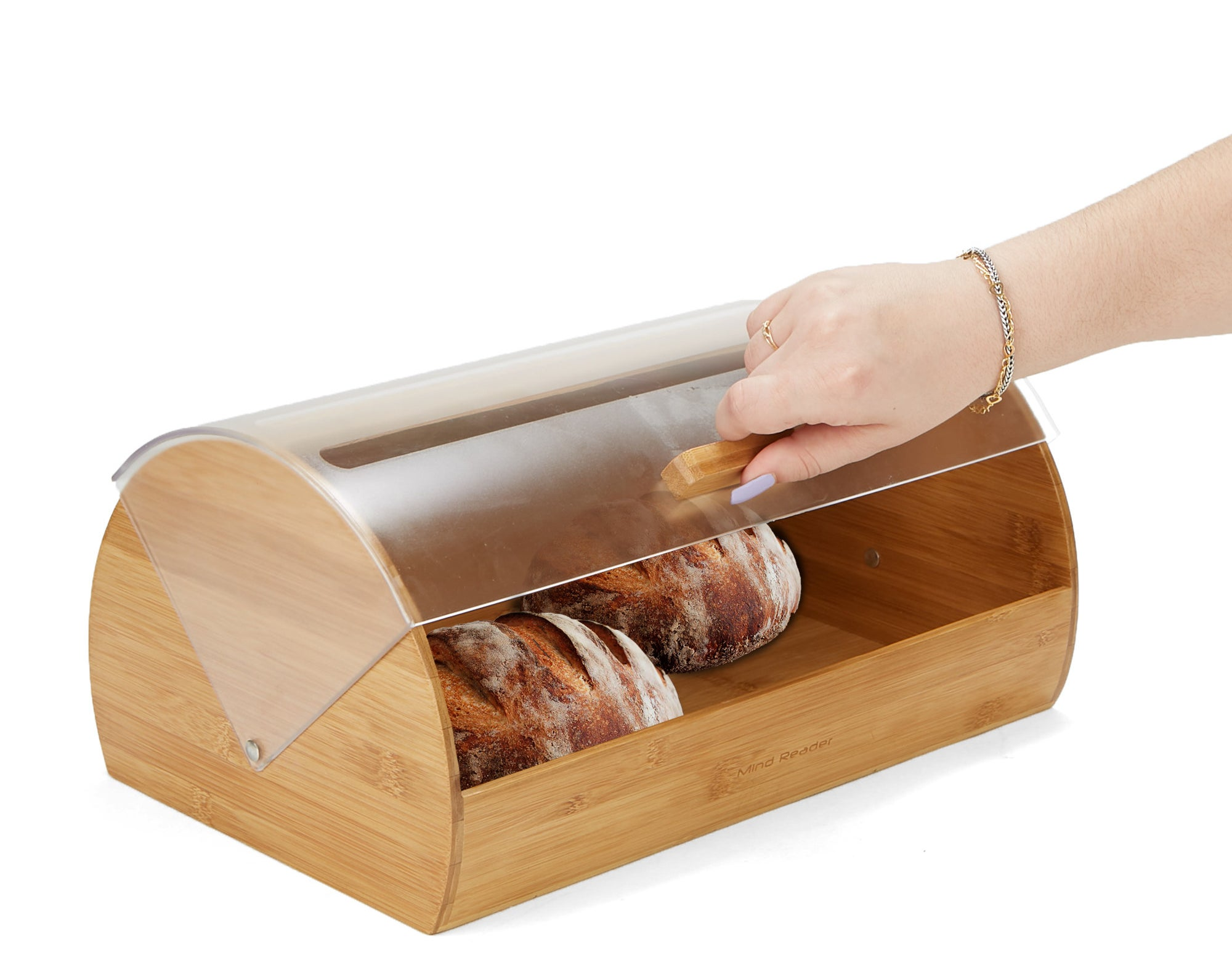 Model's hand opening the clear plastic lid of the bamboo bread box