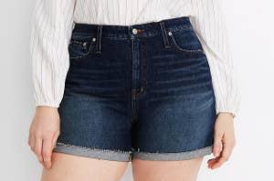 model wearing high-rise denim shorts