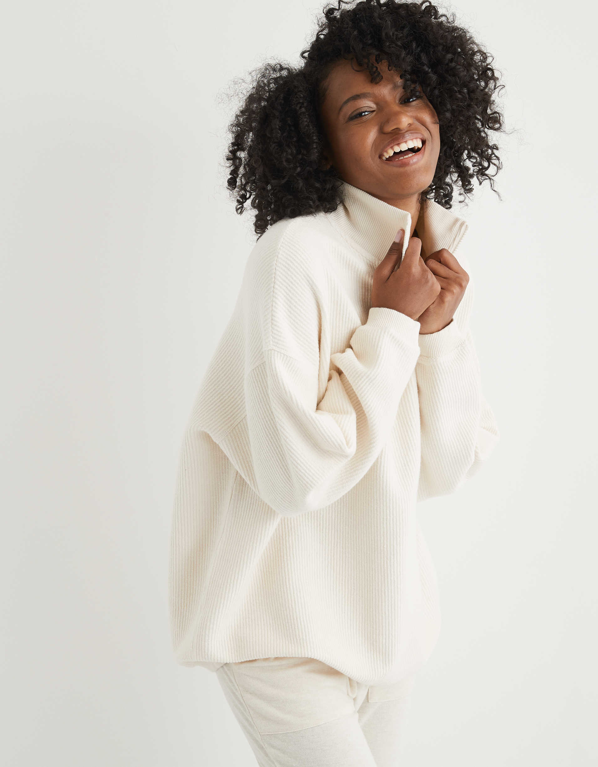 Model wearing the sweater in white