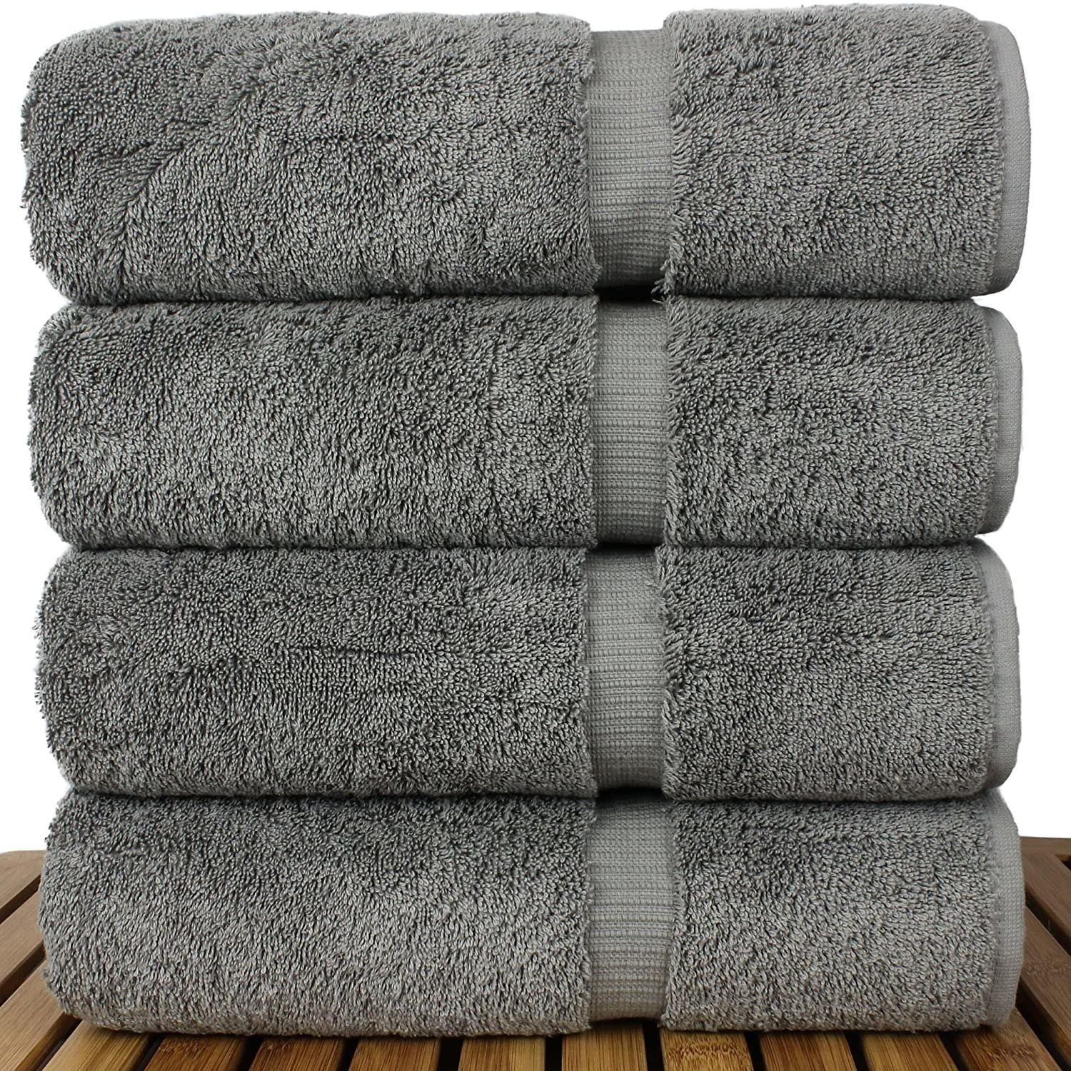 A stack of four gray linen bath towels