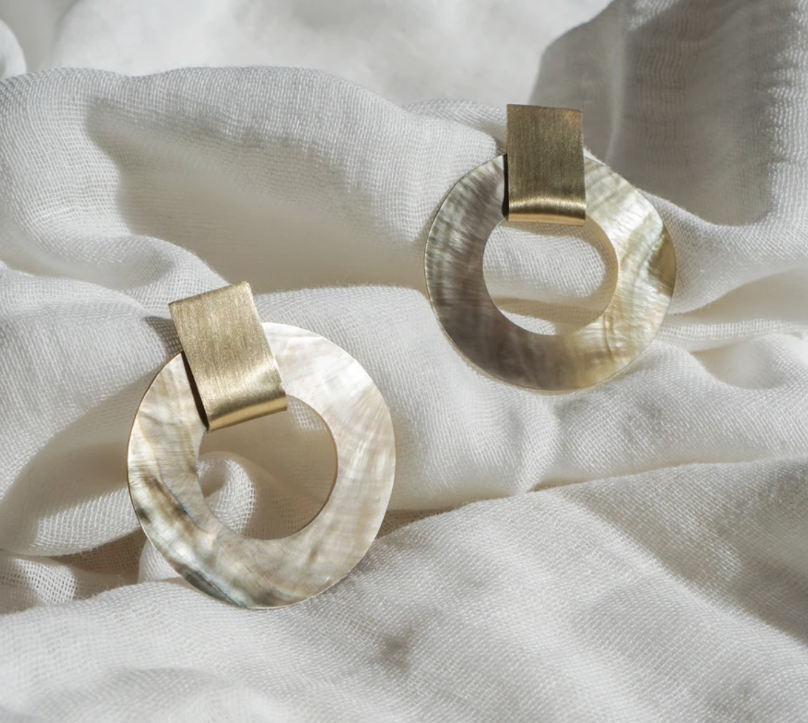 Pair of pearl hoops with a brass accent