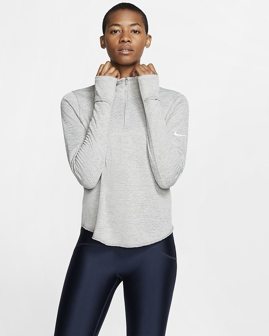 Model in the half-zip with high neck, in grey