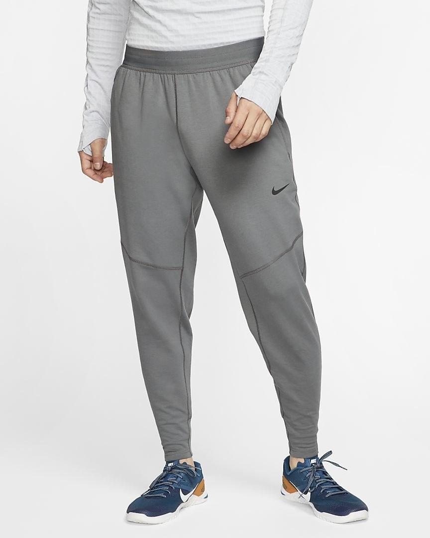 Model in the grey loose yoga pants