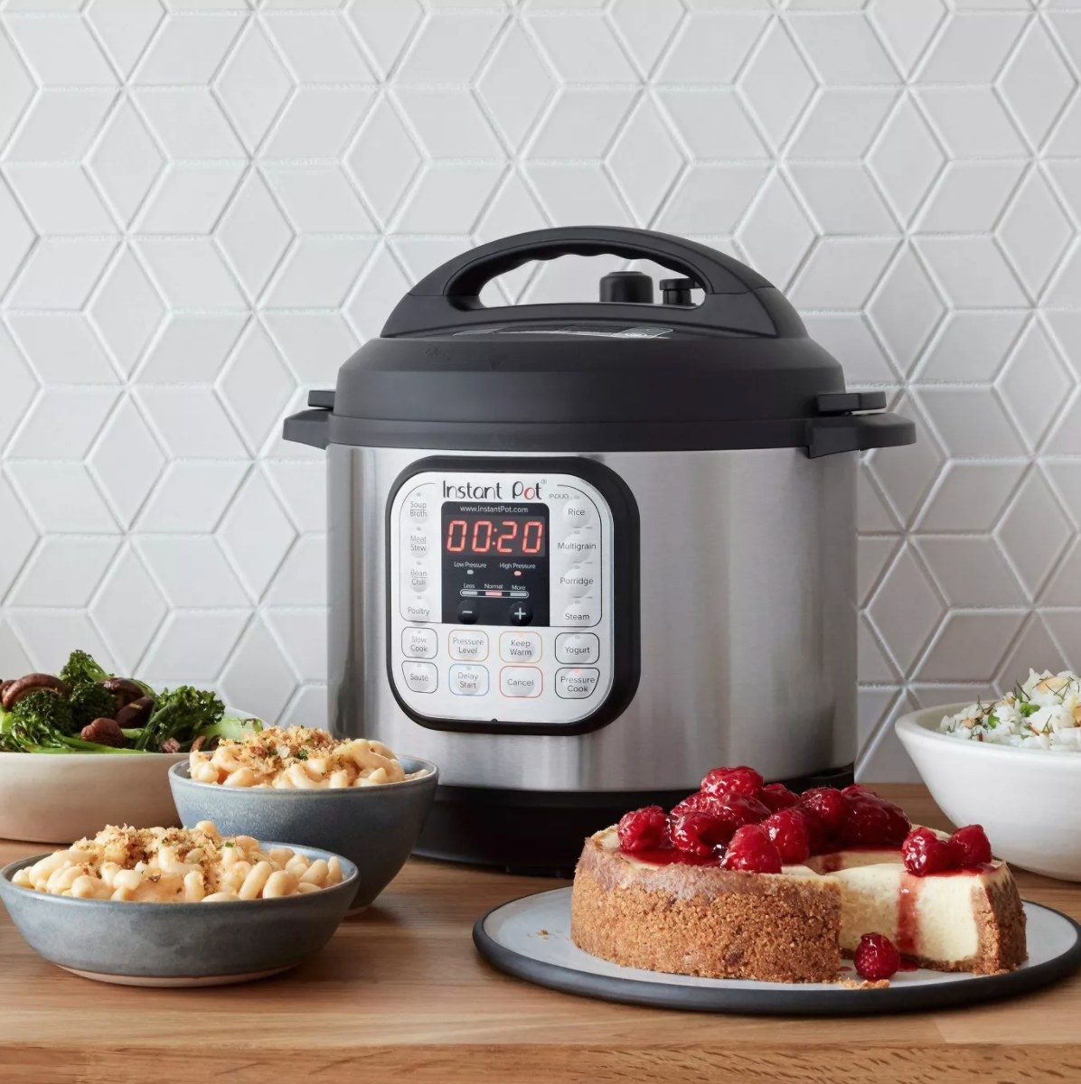 A silver InstantPot with a black top and digital screen