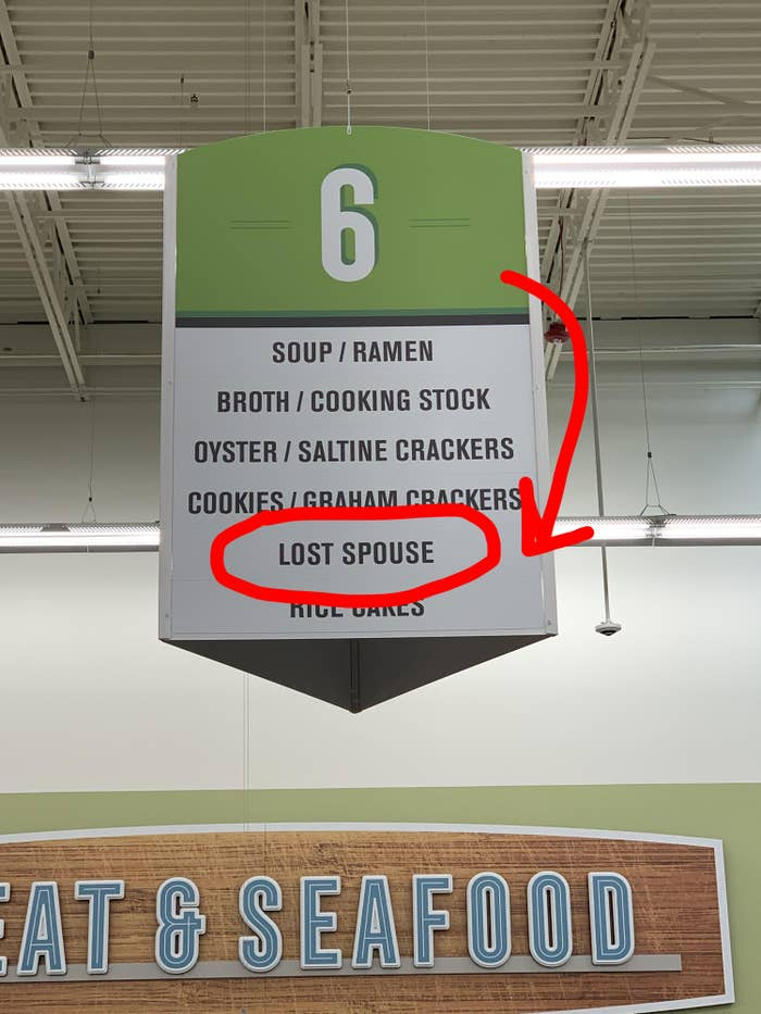 "An aisle sign that reads ""lost spouse."""