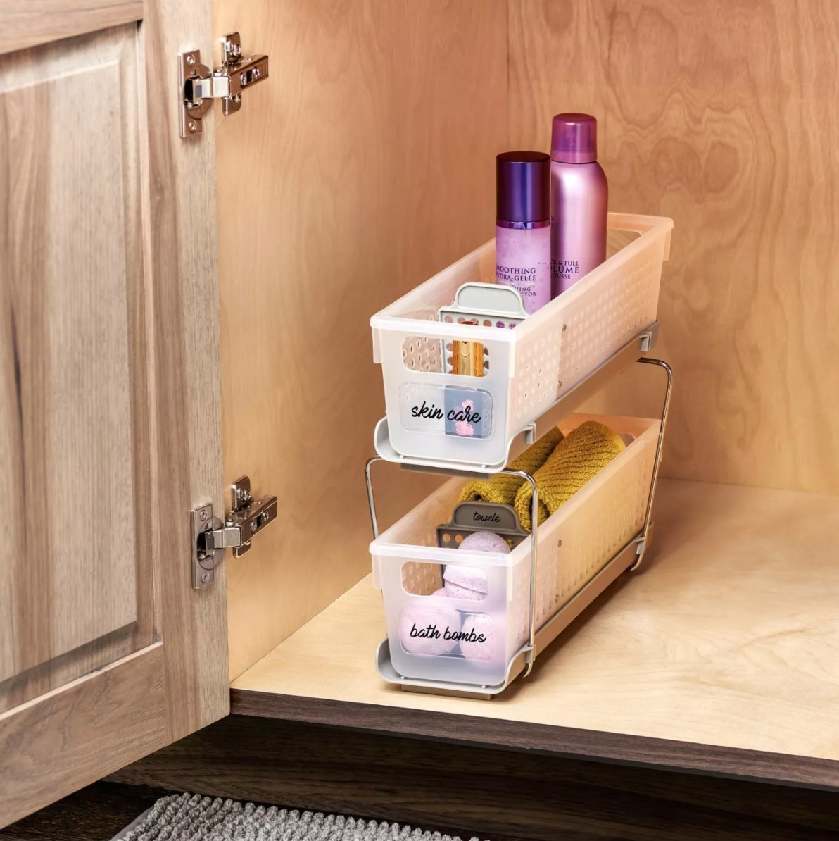 Two-tier under-sink storage with products in it