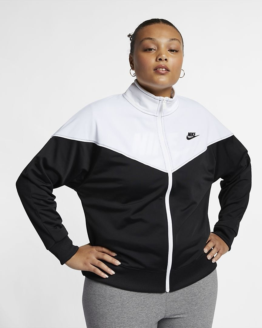 Model in the black and white track colorblock jacket