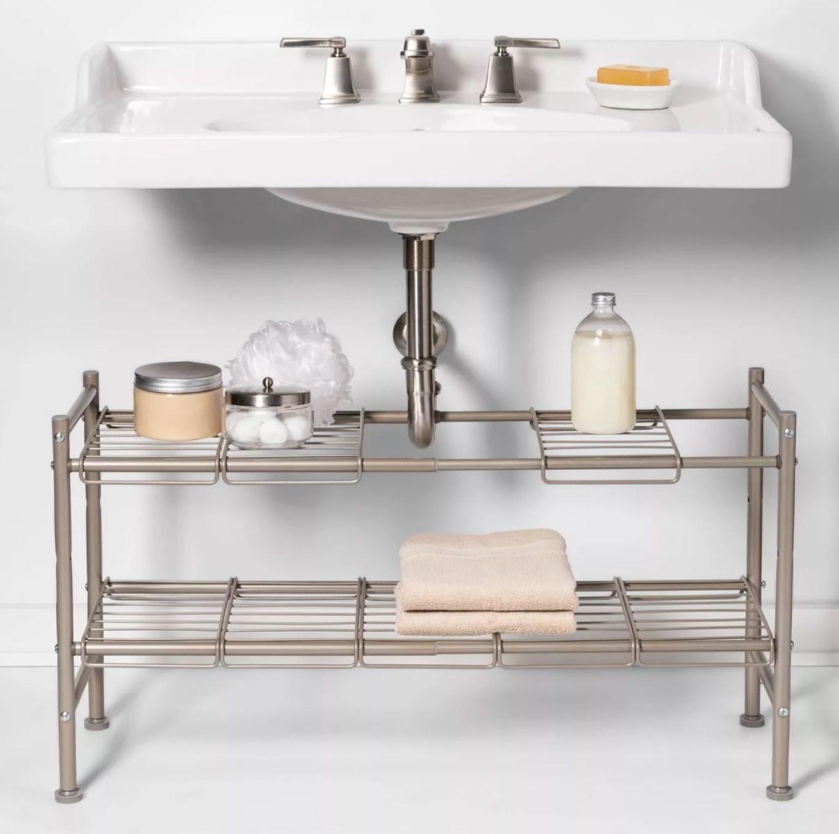 Brushed nickel under-sink, two-tier storage shelf
