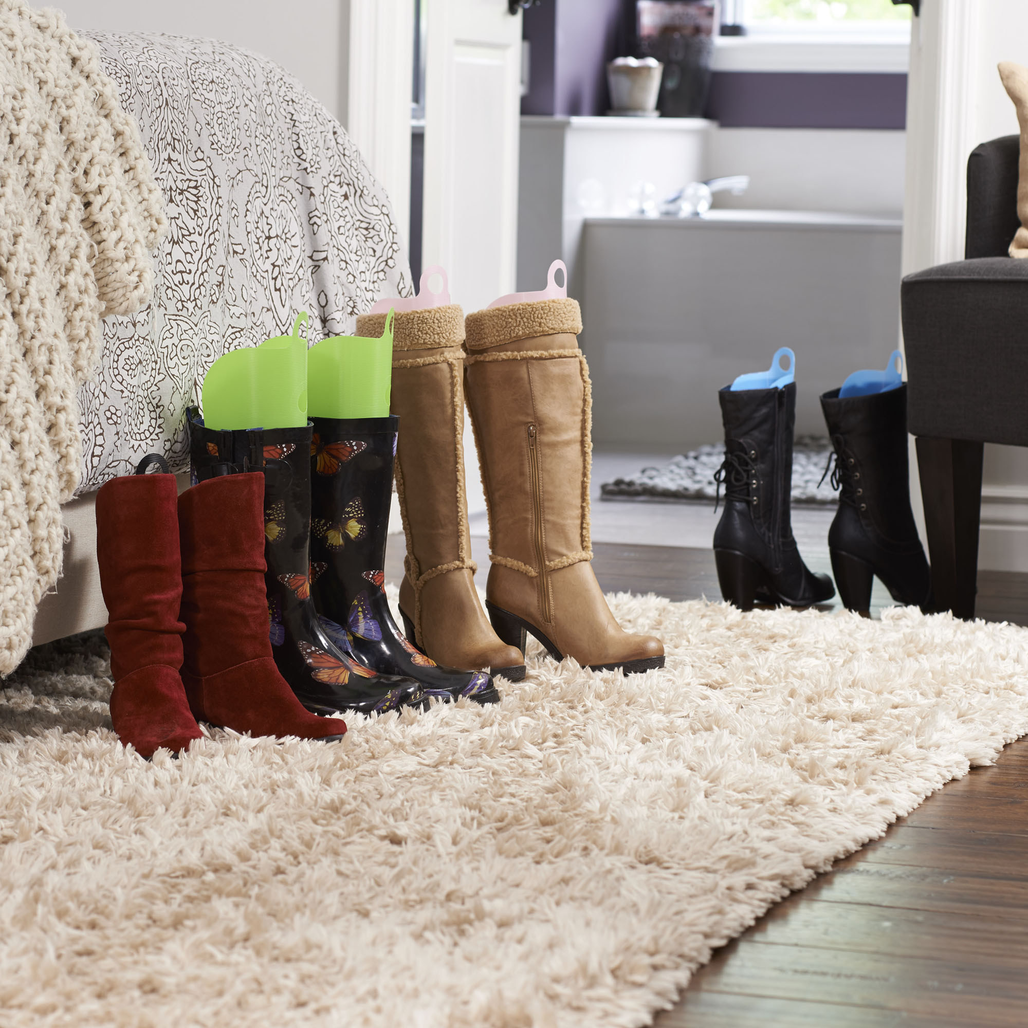 Boots with colorful boot shapers in them