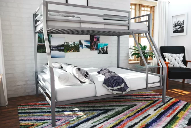 The bed, which has a twin mattress on top and a full mattress on the bottom
