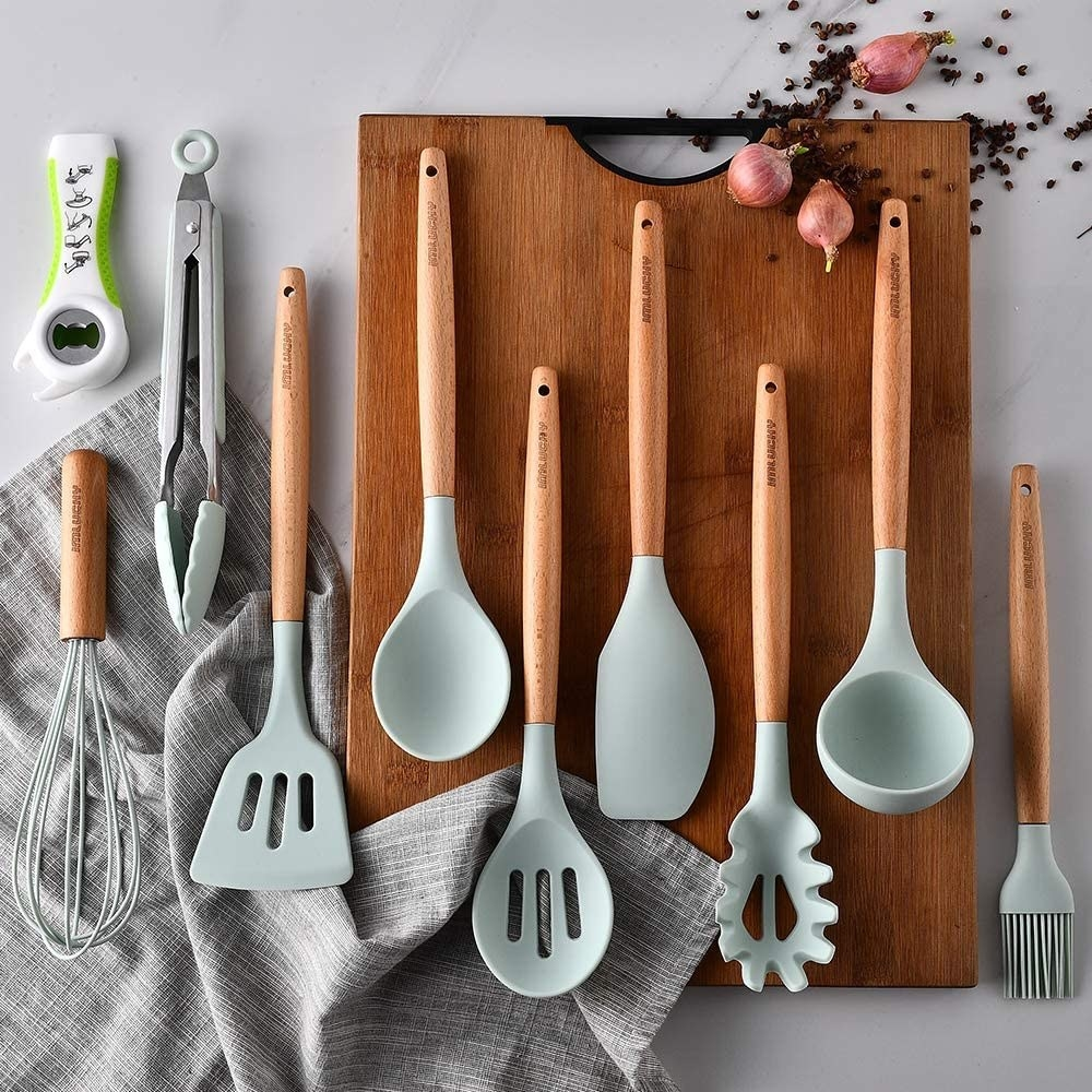The cooking utensils laid out on a cutting board