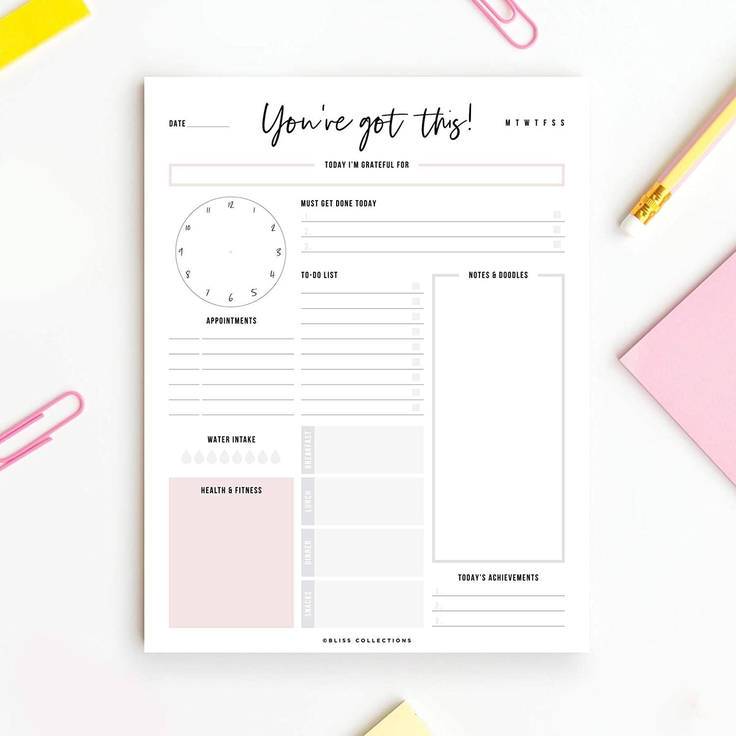 The to-do list notepad surrounded by sticky notes, pencils, and paperclips