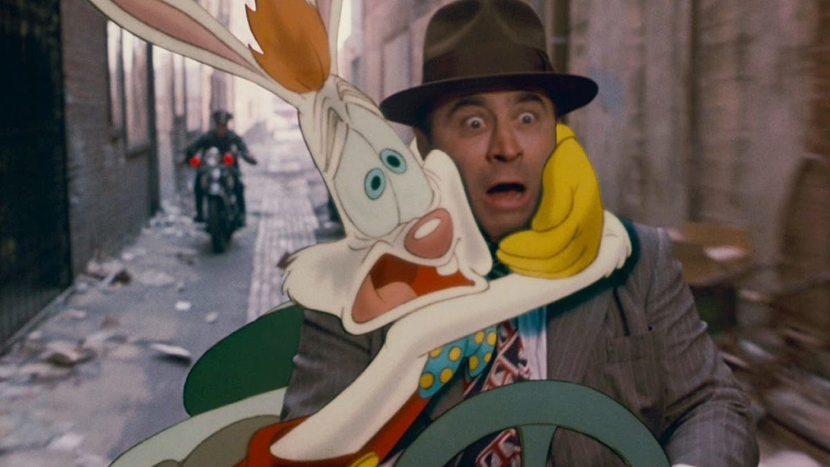 Roger Rabbit hugging detective Eddie Valient while they both look on terrified. It's the perfect representation of their relationship as Valient tries to clear Roger's name.