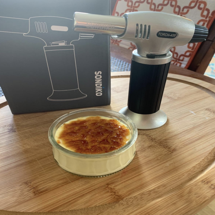 a reviewer's photo of the blow torch and a creme brule