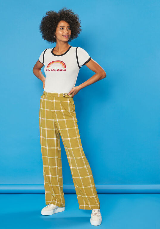 Wide leg pants in a '70s vintage windowpain plaid pattern with two brown buttons on either side of each hip