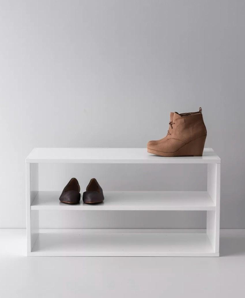 A white shoe shelf with three levels