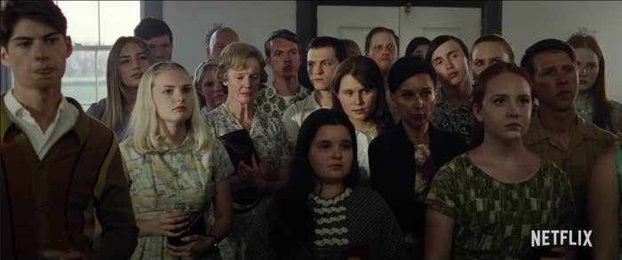 "Arvin (Tom Holland) looking at the faces of the members of his church in ""The Devil All The Time."""
